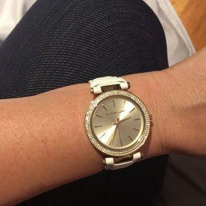 MK white band gold watch